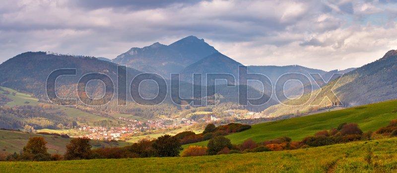 Slovakia autumn sunny morning panorama. Rural fall mountain scene. Village in valley, stock photo