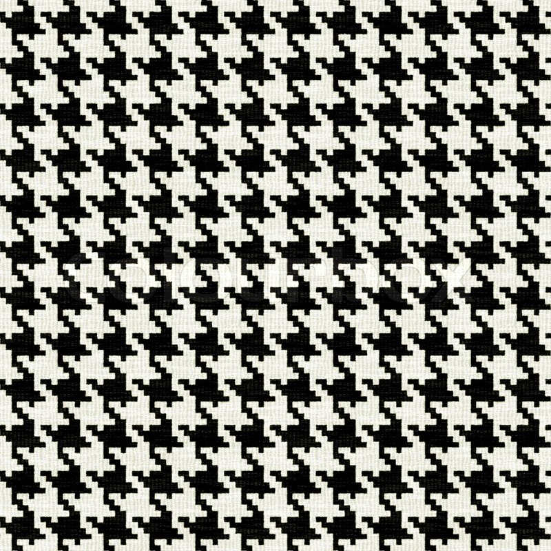 A black and white seamless hounds tooth pattern or texture ...