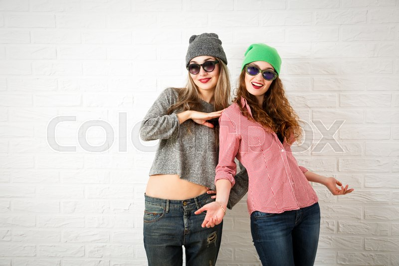 a5d7841356e0 Two Happy Smiling Hipster Girls Posing ...