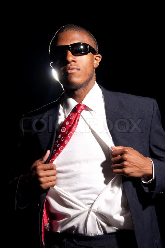 A young african american business man ripping his shirt for Start an online t shirt business at zero cost