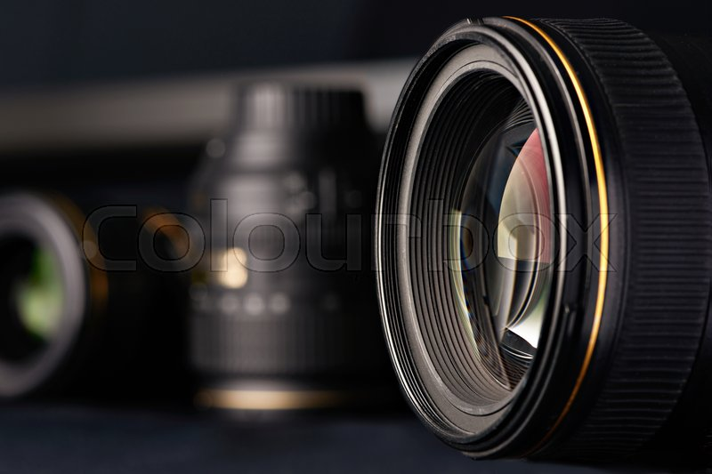 Photo lens side view on blurred object background, stock photo
