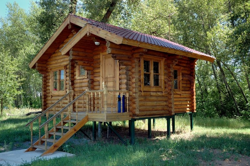 The Wooden House Established On Piles And Combined From