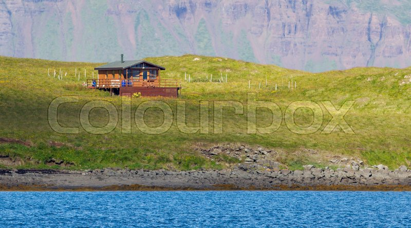 Stock image of 'Single house on an small island at the westcoast of Iceland'
