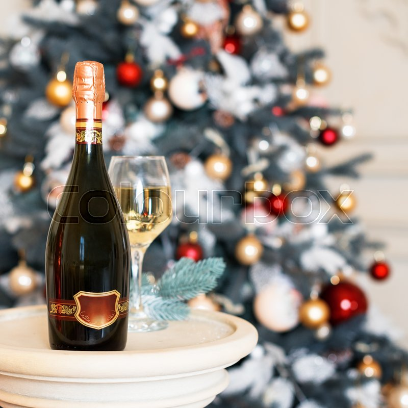 Wine in Christmas setting. New Year decorations. Winter holidays theme, stock photo