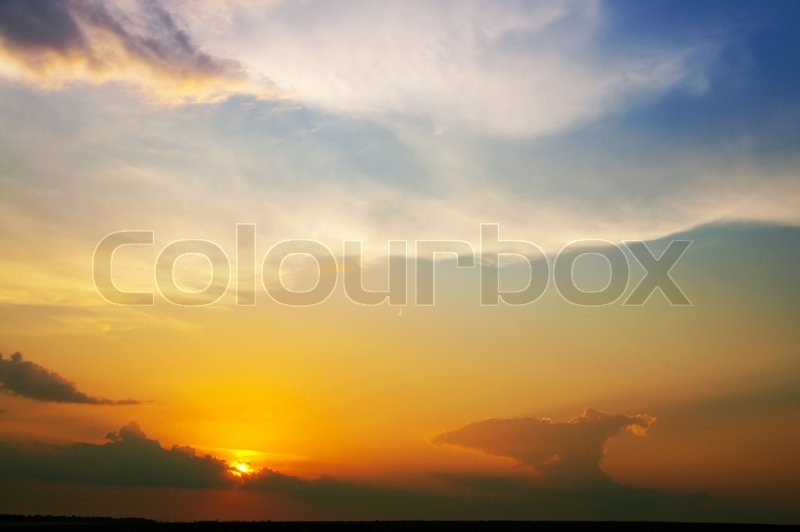Fine evening glow under low clouds, stock photo