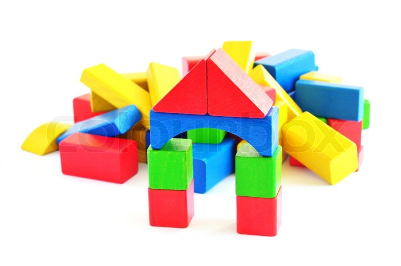 Tower made of wooden toy bricks, isolated | Stock Photo ...