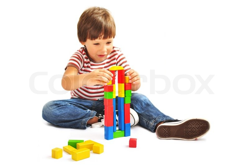 Building Toys For Little Boys : Little boy playing with building blocks isolated stock