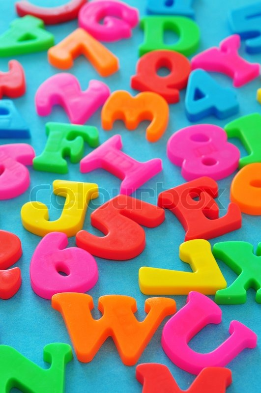 colorful magnetic letters and numbers on blue background stock photo