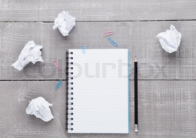 Blank writing pad with pencil for ideas on wooden background, stock photo