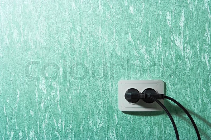 Wall outlets on the green wall, stock photo