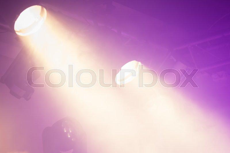 Powerful spot lights on purple background, stage illumination, stock photo