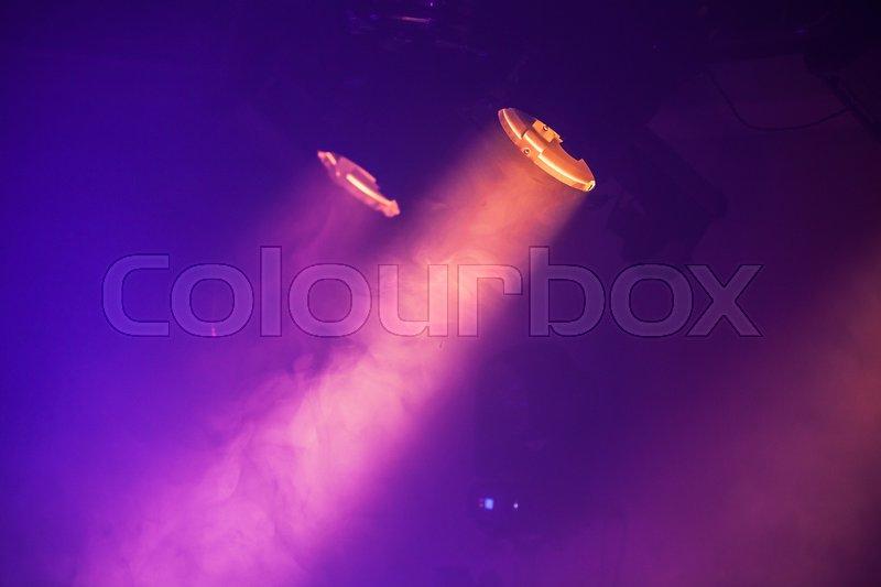Spot lights with purple rays in the dark, stage illumination equipment, stock photo