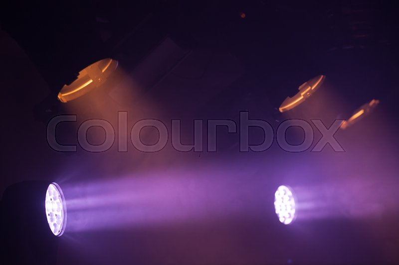 Colorful spot lights with strong beams in the dark, stage illumination background photo, stock photo