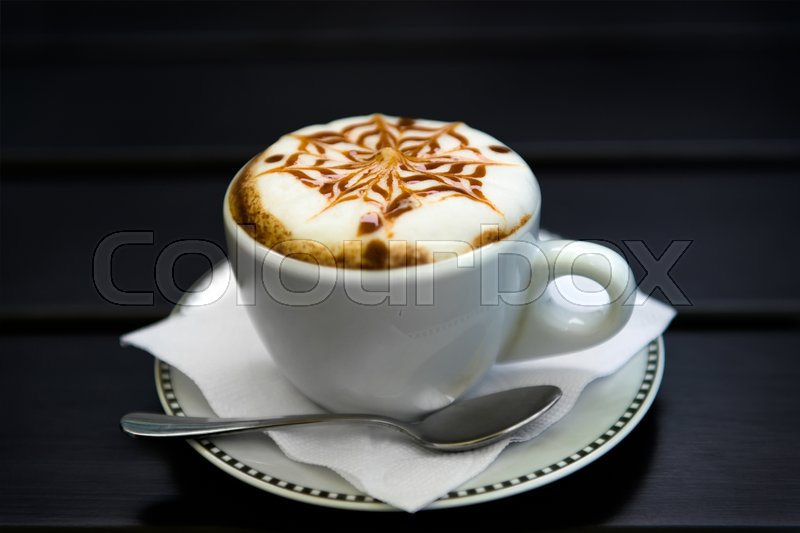 Cup of cappuccino, cup of coffee, cup of coffee on black wooden table, stock photo