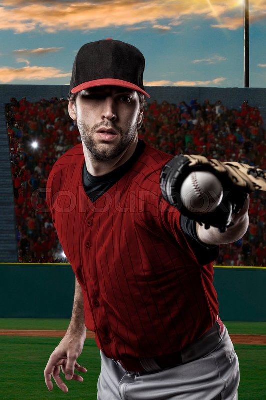 Baseball Player with a red uniform on baseball Stadium, stock photo