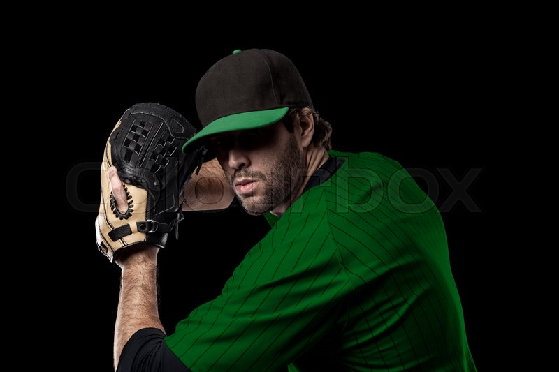 Baseball Player with a green uniform on a black background, stock photo