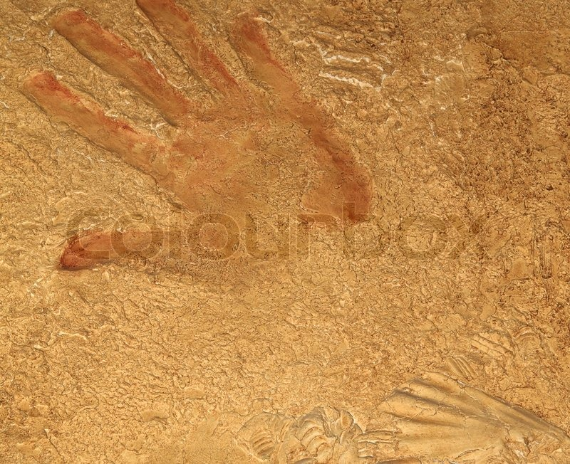 Stock image of 'Red hand print on stone background or texture'