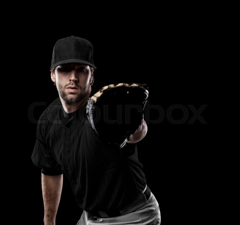 Baseball Player with a black uniform on a black background, stock photo