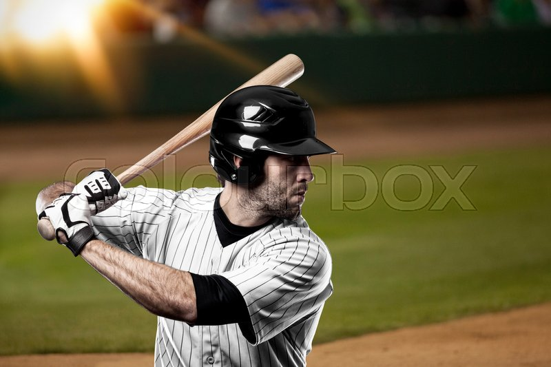 Baseball Player with a white uniform on baseball Stadium, stock photo