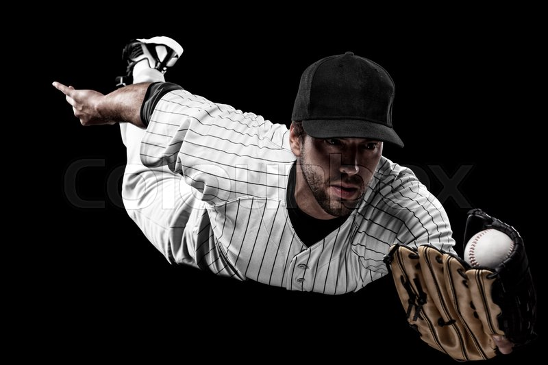 Baseball Player with a white uniform on a black background, stock photo
