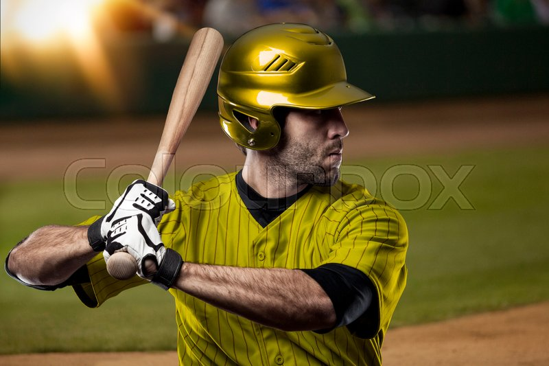Baseball Player with a yellow uniform on baseball Stadium, stock photo