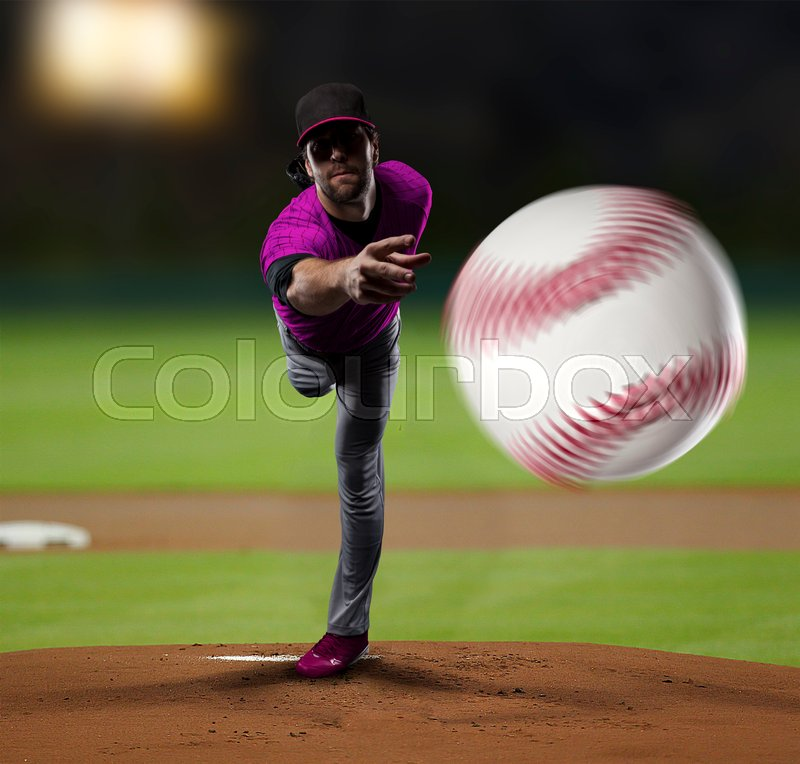 Pitcher Baseball Player with a pink uniform on baseball Stadium, stock photo