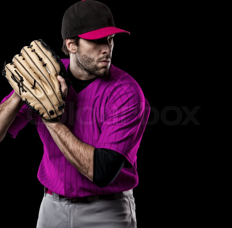 Pitcher Baseball Player with a pink uniform on a black background, stock photo