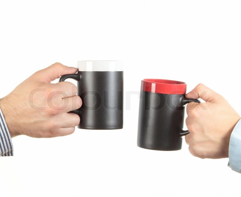 businessman hand holding a cup of tea stock photo colourbox