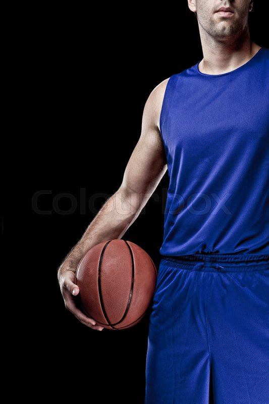 Basketball player with a ball in his hands and a Blue uniform. photography studio, stock photo