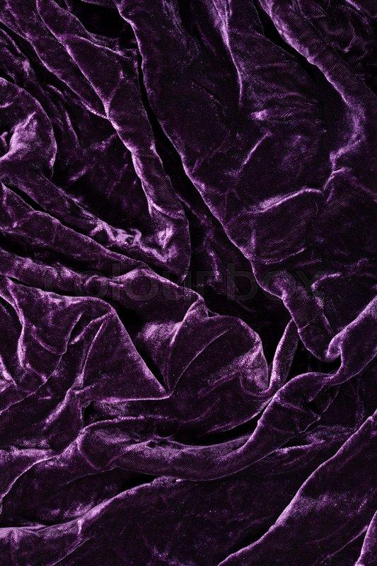 luxurious waves of dark purple velvet background stock