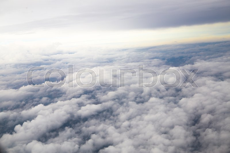 Closeup large gray clouds in the sky the view from the airplane window, stock photo