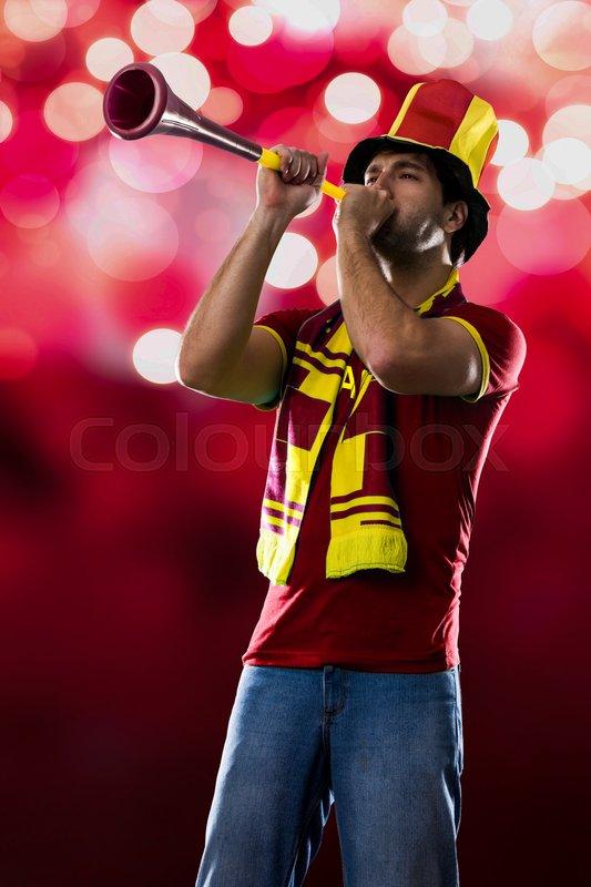 Spanish Fan Celebrating, on a Red lights background, stock photo