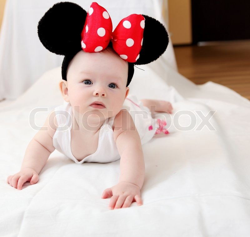 Portrait of little baby with big mouse ears, stock photo