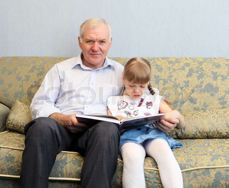 Grandfather And Granddaughter Sitting   Stock Photo -2102