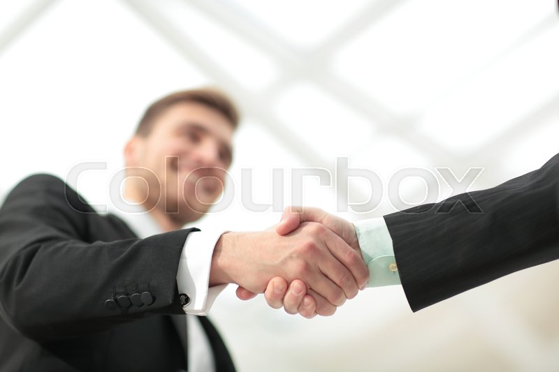 Success concept in business - handshake of partners, stock photo