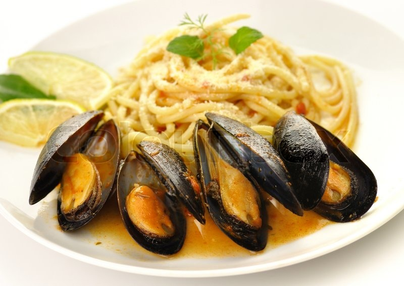 Mussels in tomato garlic sauce with spaghetti | Stock Photo ...