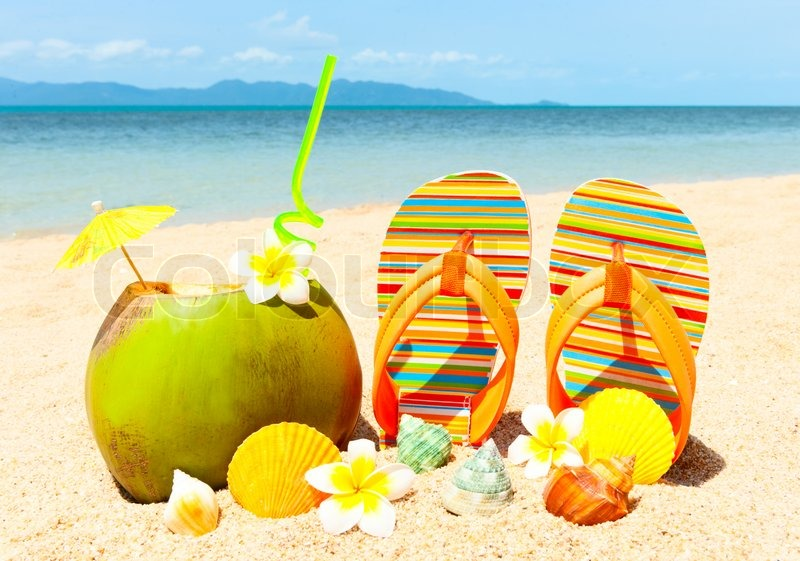 Stock image of 'Ocean Beach with palm and and exotic coctail'