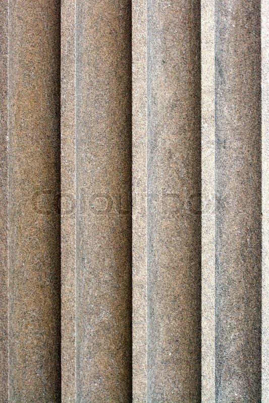 Textured Stone Pillar : An old stone column texture on the exterior of a building
