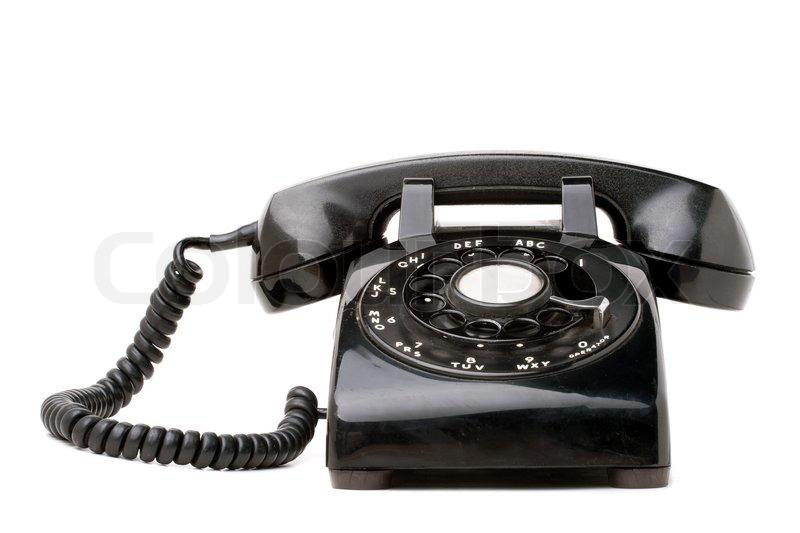 eine alte schwarze vintage dreh stil telefon ber einen wei en hintergrund isoliert stockfoto. Black Bedroom Furniture Sets. Home Design Ideas