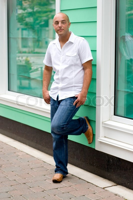 A young man in a casual pose in the     | Stock image