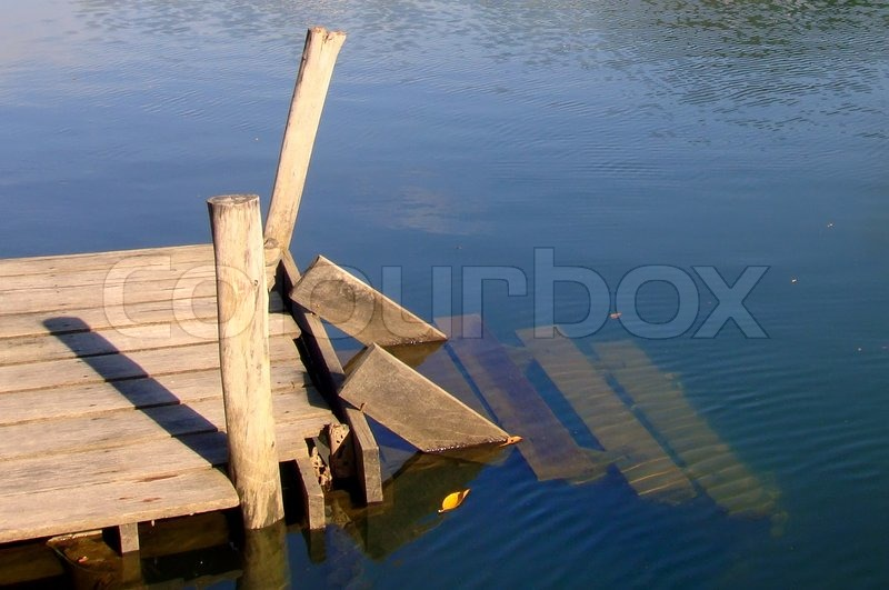 Old wooden boat dock on a beautiful lake | Stock Photo | Colourbox