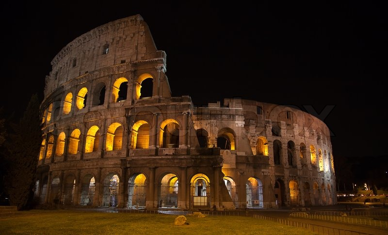 Night View Of The Ruins Of The Colloseum In Rome Italy