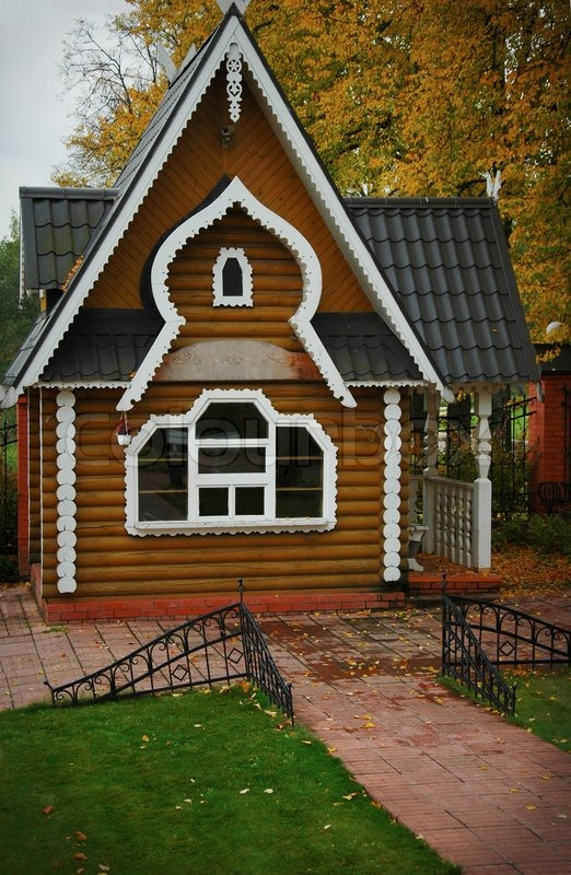 Modern Wooden Russian Traditional House In Autumn Stock