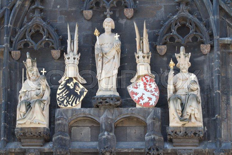 Gothic sculptures, Emperor Charles IV, bridge patron St. Veit, King Wenceslas IV, coat of arms of the Holy Roman Empire and Bohemia, Old Town Bridge Tower, Charles Bridge, Prague, Czech Republic\, stock photo