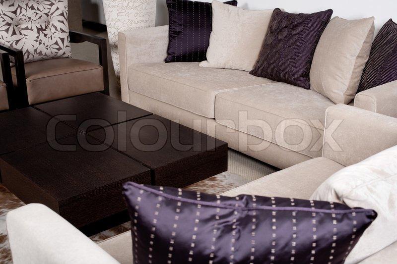 stilvolle moderne stoff couch mit reihe von kissen stockfoto colourbox. Black Bedroom Furniture Sets. Home Design Ideas