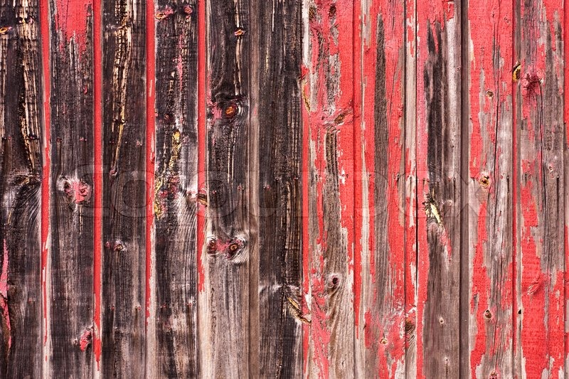An Old Worn Barn Or Wooden Fence With Chipped Red Paint