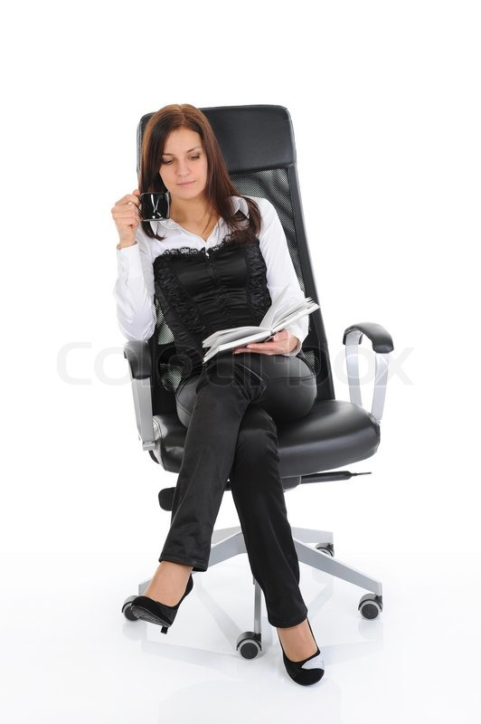 Business Woman Drinking Coffee And Reading A Book Sitting