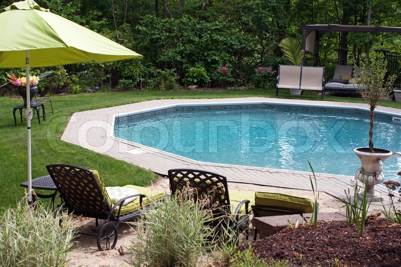 Detail View Of A Luxurious In Ground Pool And Patio LoungeThis Partly  Wooded Backyard Garden Offers The Same Level Of Luxury Found In Many  Vacation Resorts ...