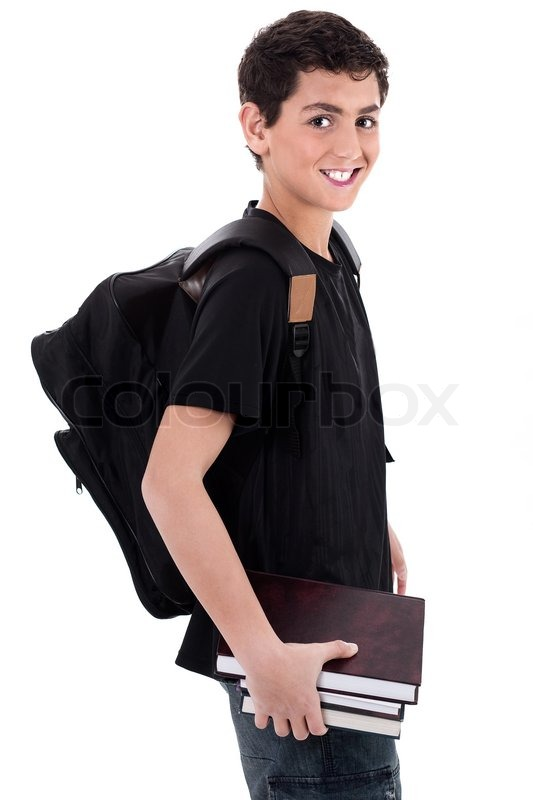Side pose of handsome teenager boy student with books in ...