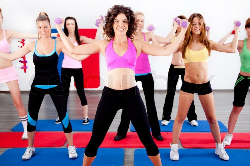 image of women doing aerobics with dumbbell stock photo colourbox